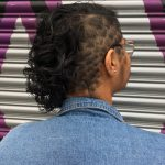 Image of haircut: pattern undercut with chin length curly hair