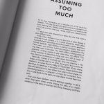 "An image of the Look book's introduction titled, ""Assuming Too Much"""