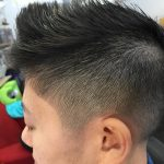 Image of a haircut: faded sides, scissor cut on top
