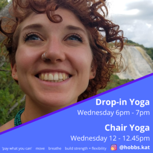 A photo of Kat Hobbs looking up to the sky and smiling. Kat has red curly hair, blue eyes and a nose piercing. Kat is outside in a rural landscape. The bottom right corner is obscured by a blue triangular shape which states: Drop-in Yoga, Wednesday 6pm - 7pm. Chair Yoga, Wednesday 12 - 12.45pm. Pay what you can, move, breathe, build strength + flexibility and the instagram handle @hobbs.kat